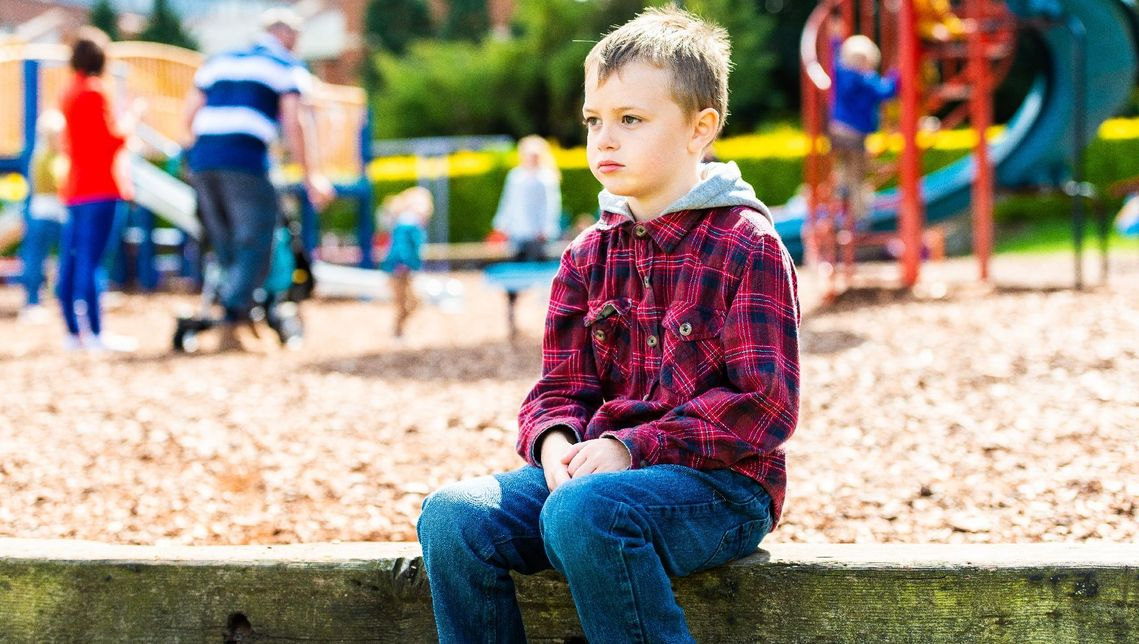 autistic boy at a playground