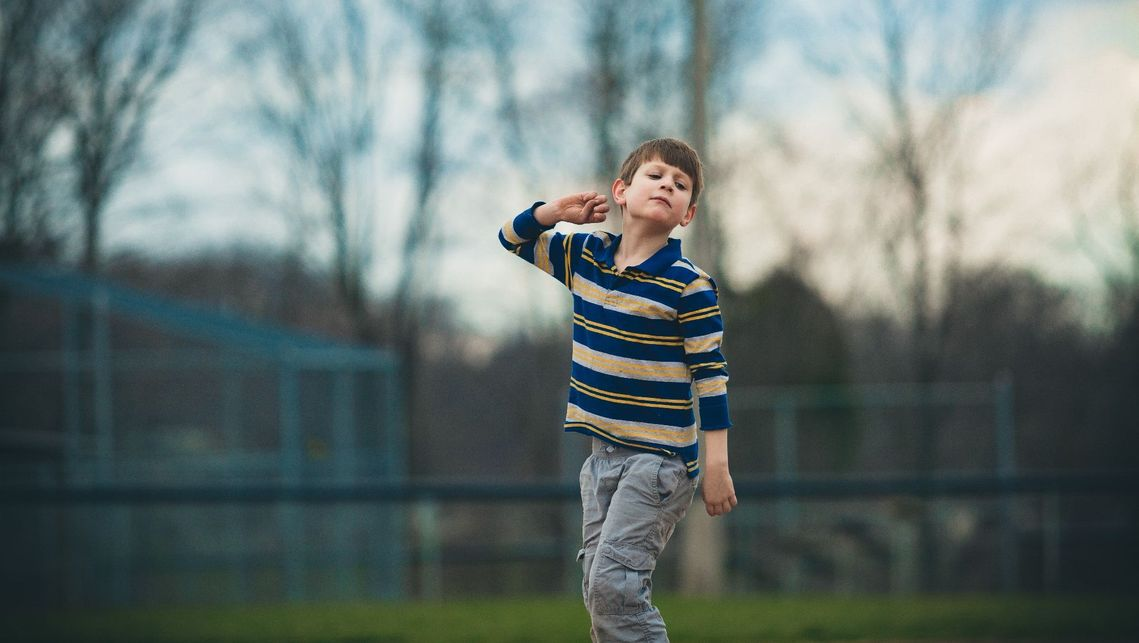 autistic child playing on a field